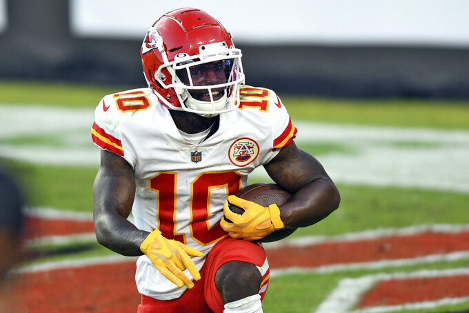 Kansas City Chiefs wide receiver Tyreek Hill (10) smiles after scoring on a 44-yard touchdown reception against the Tampa Bay Buccaneers during the first half of an NFL football game Sunday, Nov. 29, 2020, in Tampa, Fla. (AP Photo/Jason Behnken)