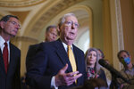Senate Minority Leader Mitch McConnell, R-Ky., is joined at left by Sen. John Barrasso, R-Wyo., speaks to reporters as intense negotiations continue to salvage a bipartisan infrastructure deal, at the Capitol in Washington, Tuesday, July 27, 2021. (AP Photo/J. Scott Applewhite)