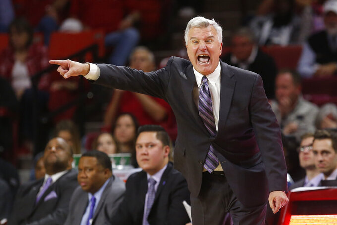 Kansas State head coach Bruce Weber shouts to his team in the second half of an NCAA college basketball game against Oklahoma in Norman, Okla., Saturday, Jan. 4, 2020. (AP Photo/Sue Ogrocki)