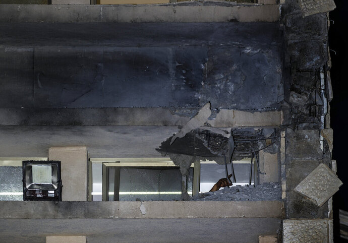 A damage to a Jewish religious school is seen in Sderot, Israel, after it was hit by a rocket fired from the Gaza Strip, Thursday, June 13, 2019. (AP Photo/Tsafrir Abayov)