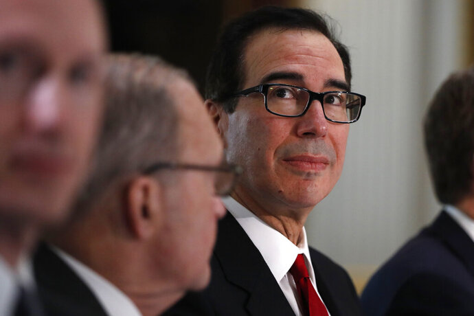 Treasury Secretary Steve Mnuchin attends a meeting of senior U.S. and Chinese officials as they meet in the Indian Treaty Room of the Eisenhower Executive Office Building on the White House complex, during continuing meetings on U.S.-China trade, Thursday, Feb. 21, 2019, in Washington. (AP Photo/Jacquelyn Martin)