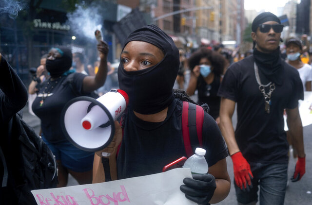 Protesters and activists move along 6th Avenue Saturday, June 6, 2020, in New York. Protests continued following the death of George Floyd, who died after being restrained by Minneapolis police officers on May 25. (AP Photo/Craig Ruttle)