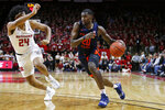 Illinois guard Da'Monte Williams (20) drives to the basket past Rutgers guard Ron Harper Jr. (24) during the first half of an NCAA college basketball game Saturday, Feb. 15, 2020, in Piscataway, N.J. (AP Photo/Adam Hunger)
