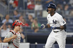 New York Yankees' Estevan Florial celebrates his solo home run, next to Philadelphia Phillies catcher J.T. Realmuto during the eighth inning of a baseball game on Tuesday, July 20, 2021, in New York. (AP Photo/Adam Hunger)