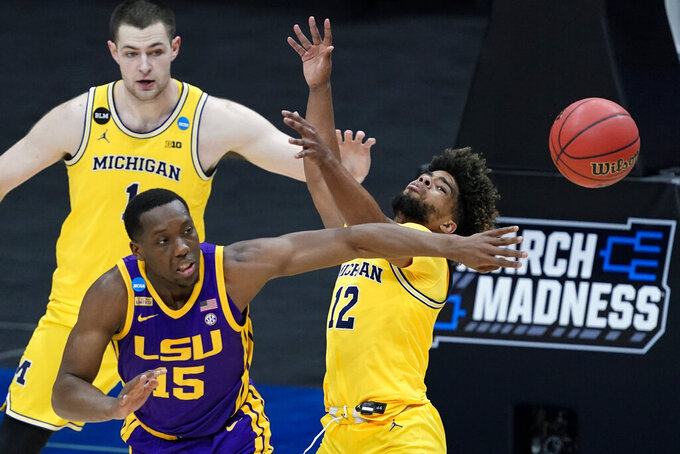 LSU guard Aundre Hyatt (15) fights for a loose ball with Michigan guard Mike Smith (12) during the first half of a second-round game in the NCAA men's college basketball tournament at Lucas Oil Stadium Monday, March 22, 2021, in Indianapolis. (AP Photo/AJ Mast)