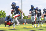 FILE - In this Aug. 7, 2019, file photograph, Mississippi running back Jerrion Ealy goes through an agility drill during  NCAA college football practice in Oxford, Miss. (Bruce Newman/Oxford Eagle via AP, File)