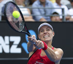Angelique Kerber of Germany hits a backhand to Ash Barty of Australia in their women's final singles match at the Sydney International tennis tournament in Sydney, Saturday, Jan. 13, 2018. (AP Photo/Rick Rycroft)