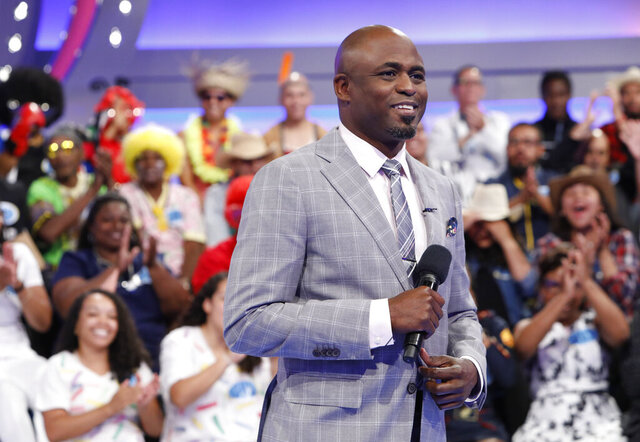 This image released by CBS shows host Wayne Brady on the set of the gameshow