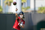 Jacksonville Jaguars quarterback Trevor Lawrence throws a pass during NFL football practice, Saturday, July 31, 2021, in Jacksonville, Fla. (AP Photo/John Raoux)