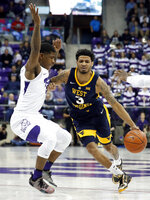 West Virginia guard James Bolden (3) drives against TCU guard Kendric Davis (5) in the first half of an NCAA college basketball game, Tuesday, Jan. 15, 2019, in Fort Worth, Texas. (AP Photo/Tony Gutierrez)