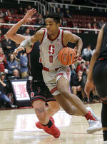 Stanford forward KZ Okpala (0) drives to the basket in front of Utah forward Timmy Allen during the second half of an NCAA college basketball game in Stanford, Calif., Thursday, Jan. 24, 2019. (AP Photo/Jeff Chiu)