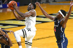 Vanderbilt guard Maxwell Evans goes to the basket as Richmond guard Blake Francis, left, and Nathan Cayo, right, defend during the first half of an NCAA college basketball game Wednesday, Dec. 16, 2020, in Nashville. (AP Photo/John Amis)