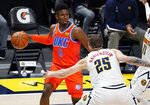 Oklahoma City Thunder guard Hamidou Diallo looks to pass the ball as Denver Nuggets center Isaiah Hartenstein defends during the second half of an NBA basketball game Tuesday, Jan. 19, 2021, in Denver. (AP Photo/David Zalubowski)