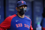 Boston Red Sox manager Alex Cora wears a protective mask as he watches during the first inning of a baseball game against the Tampa Bay Rays Monday, Aug. 30, 2021, in St. Petersburg, Fla. (AP Photo/Chris O'Meara)