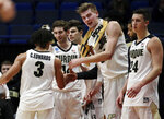 Purdue's Carsen Edwards (3) receives congratulations from Matt Haarms, second from right, and other teammates as he leaves late in the second half of a second-round men's college basketball game against Villanova in the NCAA Tournament, Saturday, March 23, 2019, in Hartford, Conn. Purdue won 87-61. (AP Photo/Elise Amendola)