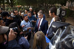 Scott Warren's attorney, Greg Kuykendall talks with media outside the Federal Courthouse after Warren's trial , Wednesday, Nov. 20, 2019 in Tucson, Ariz. Warren was acquitted Wednesday on charges he illegally harbored two Central American immigrants at a camp in southern Arizona operated by a humanitarian group. (Josh Galemore/Arizona Daily Star via AP)