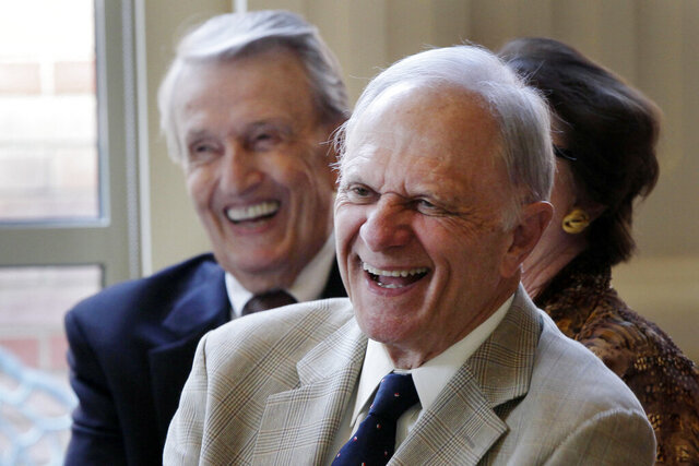 FILE - Former U.S. Senators David Pryor, right, and Dale Bumpers, both D-Ark., laugh at a joke during a meeting Wednesday, Sept. 18, 2013, at the Governor's Mansion in Little Rock, Ark. Arkansas Gov. Asa Hutchinson on Monday, July 13, 2020, said that the state needs to work to lower its number of new daily cases of the coronavirus and that Pryor, a former Arkansas governor and U.S. senator, had been hospitalized with the virus. (AP Photo/Danny Johnston, File)