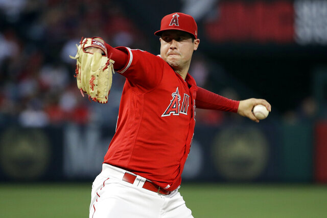 FILE - In this June 29, 2019, file photo, Los Angeles Angels starting pitcher Tyler Skaggs throws to the Oakland Athletics during a baseball game in Anaheim, Calif. Federal prosecutors say a former Angels employee has been charged with conspiracy to distribute fentanyl in connection with last year's overdose death of Angels pitcher Tyler Skaggs. Prosecutors in Texas say Eric Prescott Kay was arrested in Fort Worth, Texas, and made his first appearance Friday, Aug. 7, 2020, in federal court. Kay was communications director for the Angels. (AP Photo/Marcio Jose Sanchez, File)