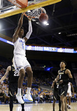UCLA guard Chris Smith (5) dunks against Colorado during the second half of an NCAA college basketball game Wednesday, Feb. 6, 2019, in Los Angeles. (AP Photo/Marcio Jose Sanchez)