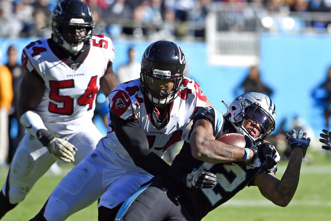 Atlanta Falcons defensive end Vic Beasley (44) tackles Carolina Panthers wide receiver D.J. Moore (12) during the first half of an NFL football game in Charlotte, N.C., Sunday, Nov. 17, 2019. (AP Photo/Mike McCarn)