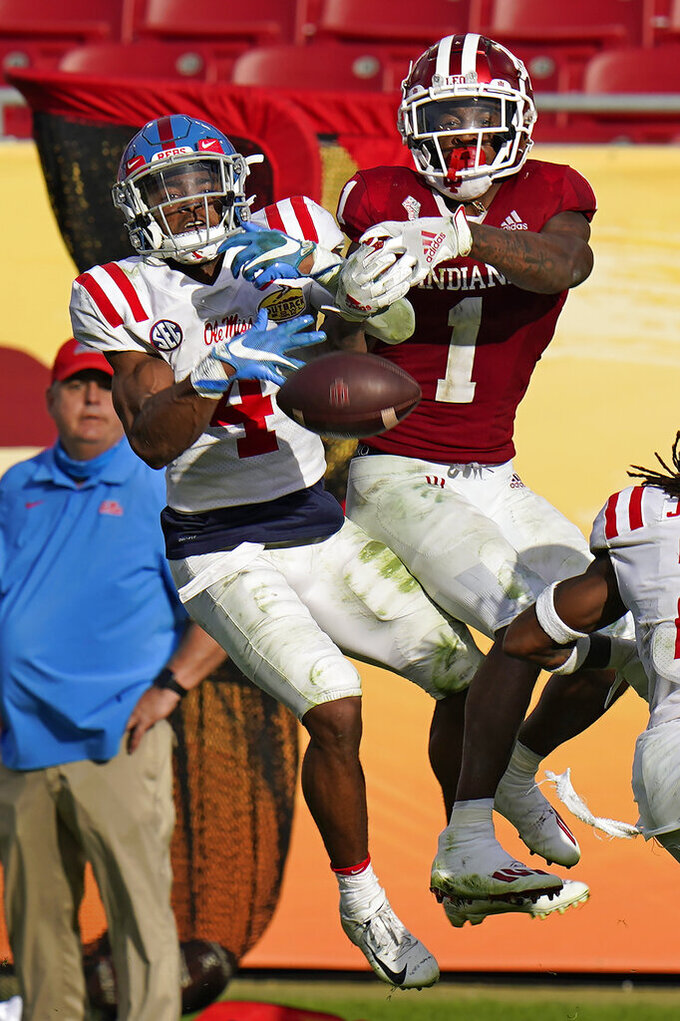 Mississippi defensive back Tylan Knight (4) breaks up a pass intended for Indiana wide receiver Whop Philyor (1) during the second half of the Outback Bowl NCAA college football game Saturday, Jan. 2, 2021, in Tampa, Fla. (AP Photo/Chris O'Meara)