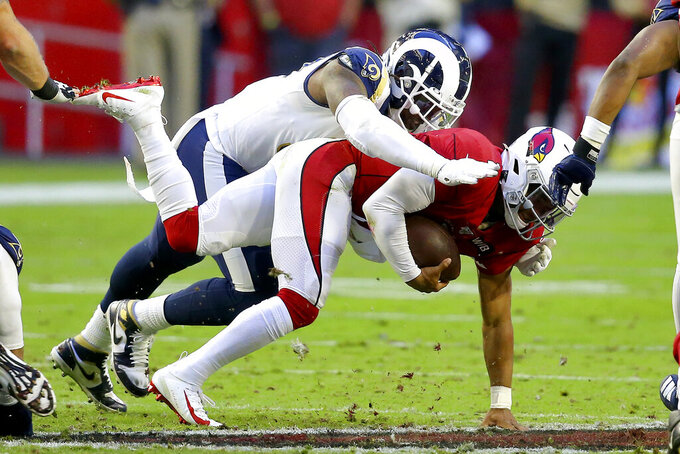 Arizona Cardinals quarterback Kyler Murray, right, is sacked by Los Angeles Rams defensive end Michael Brockers during the second half of an NFL football game, Sunday, Dec. 1, 2019, in Glendale, Ariz. (AP Photo/Ross D. Franklin)