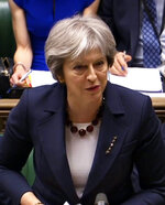 Britain's Prime Minister Theresa May speaks during the scheduled Prime Minister's Questions in the House of Commons, London, Wednesday March 14, 2018.   May is widely expected to announce a range of economic and diplomatic measures against Russia, in response to the nerve-agent poisoning of former Russian spy Sergei Skripal and his daughter Yulia. (PA via AP)