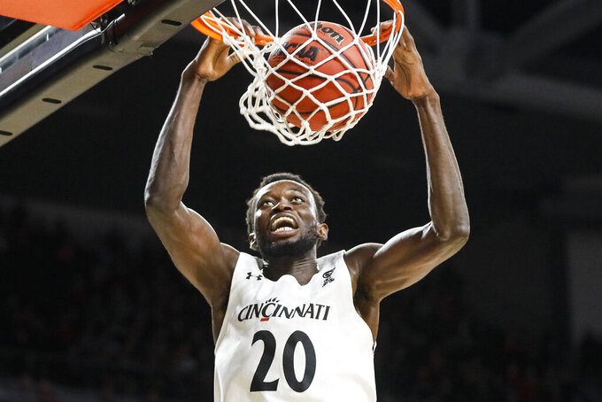 Cincinnati's Mamoudou Diarra dunks during the second half of an NCAA college basketball game against East Carolina, Sunday, Jan. 19, 2020, in Cincinnati. (AP Photo/John Minchillo)
