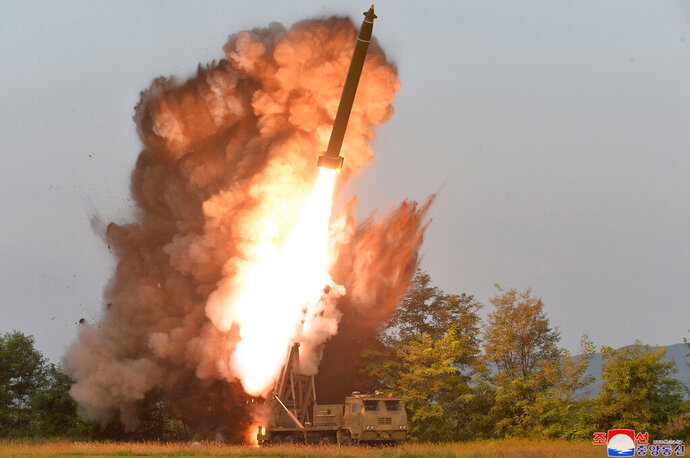 This Tuesday, Sept. 10, 2019, photo provided by the North Korean government shows a test-firing from a multiple rocket launcher at an undisclosed location in North Korea. KCNA reports North Korean leader Kim Jong Un visited the site. The content of this image is as provided and cannot be independently verified. Korean language watermark on image as provided by source reads: