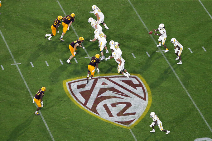 FILE - In this Aug. 29, 2019, file photo, is the Pac-12 logo during the second half of an NCAA college football game between Arizona State and Kent State, in Tempe, Ariz. The return of football isn't likely to make much of a dent in the losses athletic departments across the Pac-12 will ultimately incur because of the coronavirus pandemic. Faced with dramatic budget shortfalls, most schools in the league have already resorted to layoffs, furloughs, and cutting some sports entirely. (AP Photo/Ralph Freso, File)