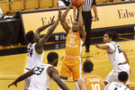 Tennessee's Yves Pons, center, shoots the ball over Missouri's Kobe Brown, left, Jeremiah Tilmon (23) and Dru Smith, right, during the first half of an NCAA college basketball game Wednesday, Dec. 30, 2020, in Columbia, Mo. (AP Photo/L.G. Patterson)