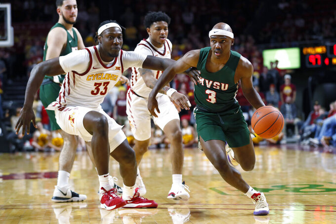 Mississippi Valley State guard Caleb Hunter (3) drives past Iowa State forward Solomon Young (33) during the second half of an NCAA college basketball game, Tuesday, Nov. 5, 2019, in Ames, Iowa. Iowa State won 110-74. (AP Photo/Charlie Neibergall)