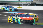 William Byron (24) drives through a turn during practice for the NASCAR Cup Series auto race at Indianapolis Motor Speedway in Indianapolis, Saturday, Aug. 14, 2021. (AP Photo/Michael Conroy)