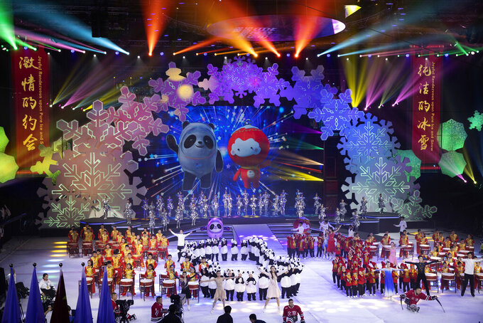 FILE - In this Sept. 17, 2019, file photo, Beijing 2022 Winter Olympic Mascot Bing Dwen Dwen, left on screen and 2022 Winter Paralympic Games mascot Shuey Rong Rong, right on screen are revealed during a ceremony held at the Shougang Ice Hockey Arena in Beijing. Uncertainty surrounds how the postponed Tokyo Olympics will be held next year in the midst of the coronavirus. The same questions permeate three mega-events that will be staged in China within a year after the Tokyo Games close. (AP Photo/Ng Han Guan, File)