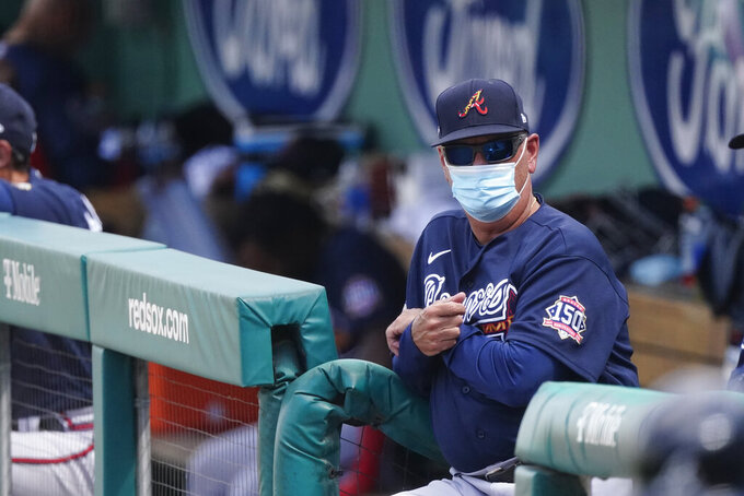 Atlanta Braves manager Brian Snitker watches from the dugout as his team plays the Boston Red Sox in a spring training baseball game Wednesday, March 10, 2021, in Fort Myers, Fla. (AP Photo/John Bazemore)