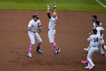New York Yankees' Giancarlo Stanton, left, celebrates his walkoff single with teammates during the ninth inning of a baseball game against the Washington Nationals at Yankee Stadium, Sunday, May 9, 2021, in New York. (AP Photo/Seth Wenig)