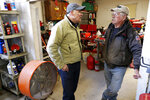 2020 Democratic presidential candidate Washington Gov. Jay Inslee talks with Ron Perry, of Hamburg, Iowa, right, while touring flood damage, Friday, April 12, 2019, in Hamburg, Iowa. (AP Photo/Charlie Neibergall)