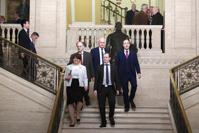 Arlene Foster of the DUP leads her party into the chamber at Parliament Buildings, Stormont, Belfast, Northern Ireland, Saturday Jan. 11, 2020. Legislators returned to Northern Ireland's assembly Saturday for the first time in three years, after a deal was struck to restore the divided region's mothballed power-sharing government. (Michael Cooper/PA via AP)
