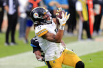 Pittsburgh Steelers wide receiver Chase Claypool makes a reception in front of Jacksonville Jaguars cornerback Chris Claybrooks for a 31-yard touchdown during the first half of an NFL football game, Sunday, Nov. 22, 2020, in Jacksonville, Fla. (AP Photo/Matt Stamey)