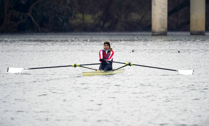 Rower Gevvie Stone trains at Lady Bird Lake ahead of the upcoming U.S. Olympic rowing trials, Friday, Feb. 12, 2021, in Austin, Texas.  The 35-year-old, two-time Olympian and 2016 silver medalist in women's single sculls will be rowing for a return to the Olympics starting Monday, Feb. 20  when the U.S. trials begin in Sarasota, Fla. (AP Photo/Eric Gay)