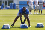 Detroit Lions defensive tackle Mike Daniels runs a drill during NFL football practice in Allen Park, Mich., Sunday, July 28, 2019. (AP Photo/Paul Sancya)