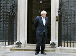 FILE - In this Sept. 5, 2019, file photo, British Prime Minister Boris Johnson stands outside Downing Street in London. Johnson's remark that day,