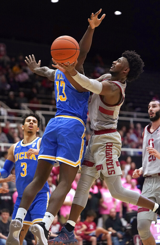 Stanford guard Daejon Davis (1) drives to the basket against UCLA guard Kris Wilkes (13) during the second half of an NCAA college basketball game Saturday, Feb. 16, 2019, in Stanford, Calif. (AP Photo/Tony Avelar)