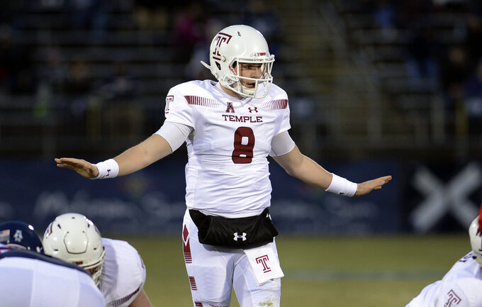 Temple quarterback Frank Nutile (8) sets up his team in the second half of an NCAA college football game against Connecticut, Saturday, Nov. 24, 2018, in East Hartford, Conn. (AP Photo/Stephen Dunn)