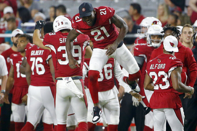 Arizona Cardinals defensive back Tyler Sigler (39) celebrates his interception against the Los Angeles Chargers with Patrick Peterson (21) during the second half of an NFL preseason football game, Thursday, Aug. 8, 2019, in Glendale, Ariz. (AP Photo/Rick Scuteri)