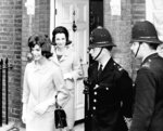 FILE - In this June 6, 1961 file photo,  Jacqueline Kennedy is followed by her sister, Lee Radziwill, in London. Radziwill, the stylish jet setter and socialite who made friends worldwide even as she bonded and competed with her older sister Jacqueline Kennedy, has died. She was 85. Anna Christina Radziwill told The New York Times her mother died Friday, Feb. 15, 2019, of what she described as natural causes. (AP Photo, File)
