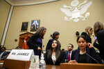Yazmin Juárez, center, whose daughter Mariee, 1, died after being released from detention by U.S. Immigration and Customs Enforcement (ICE), takes her seat to testify at a House Oversight subcommittee hearing on Civil Rights and Civil Liberties on the treatment of immigrant children at the southern border, Wednesday, July 10, 2019, on Capitol Hill in Washington. (AP Photo/Jacquelyn Martin)