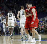 Texas Tech's Davide Moretti (25) and Matt Mooney celebrate after defeating Michigan State 61-51 in the second half in the semifinals of the Final Four NCAA college basketball tournament, Saturday, April 6, 2019, in Minneapolis. (AP Photo/David J. Phillip)
