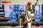 Appalachian State forward RJ Duhart (4), left, tries to block a shot by Norfolk State forward J.J. Matthews (15) during the second half of a First Four game in the NCAA men's college basketball tournament, Thursday, March 18, 2021, in Bloomington, Ind. (AP Photo/Doug McSchooler)