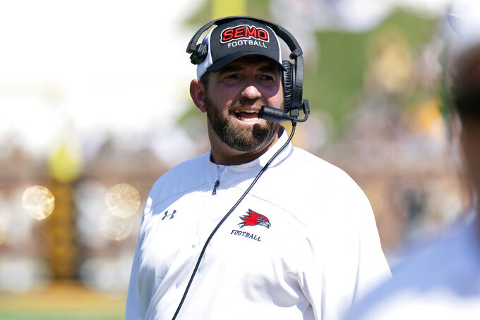 Southeast Missouri State head coach Tom Matukewicz talks with coaches on the sideline during the second quarter of an NCAA college football game against Missouri, Saturday, Sept. 18, 2021, in Columbia, Mo. (AP Photo/L.G. Patterson)